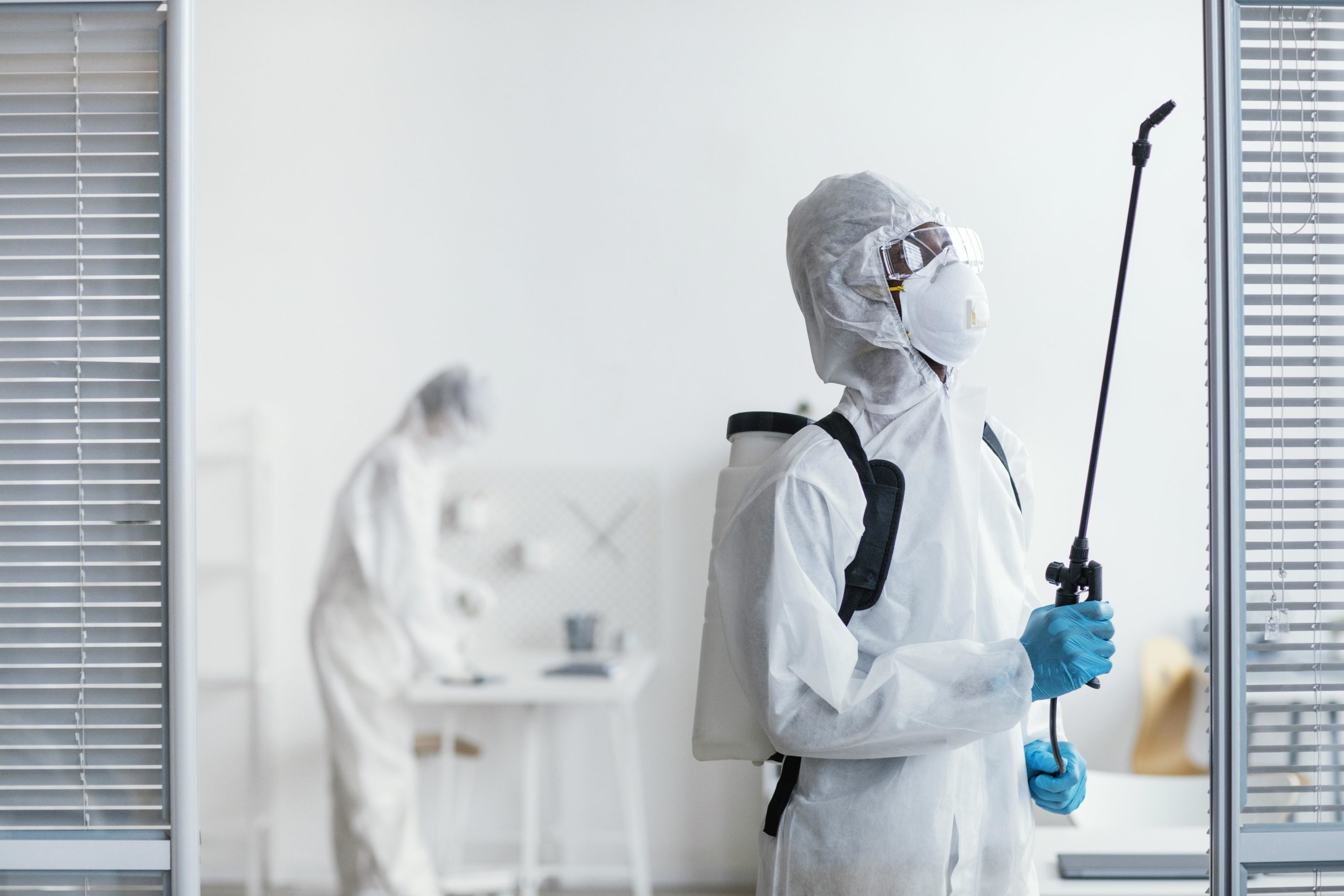 people-disinfecting-together-dangerous-area